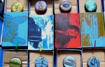 Matchbox Lithographs and Oil Painted Bottle Tops by Sheena Vallely